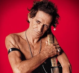 Keith Richards w/guitar: naked from the waist up; VERY old, VERY wrinkled,